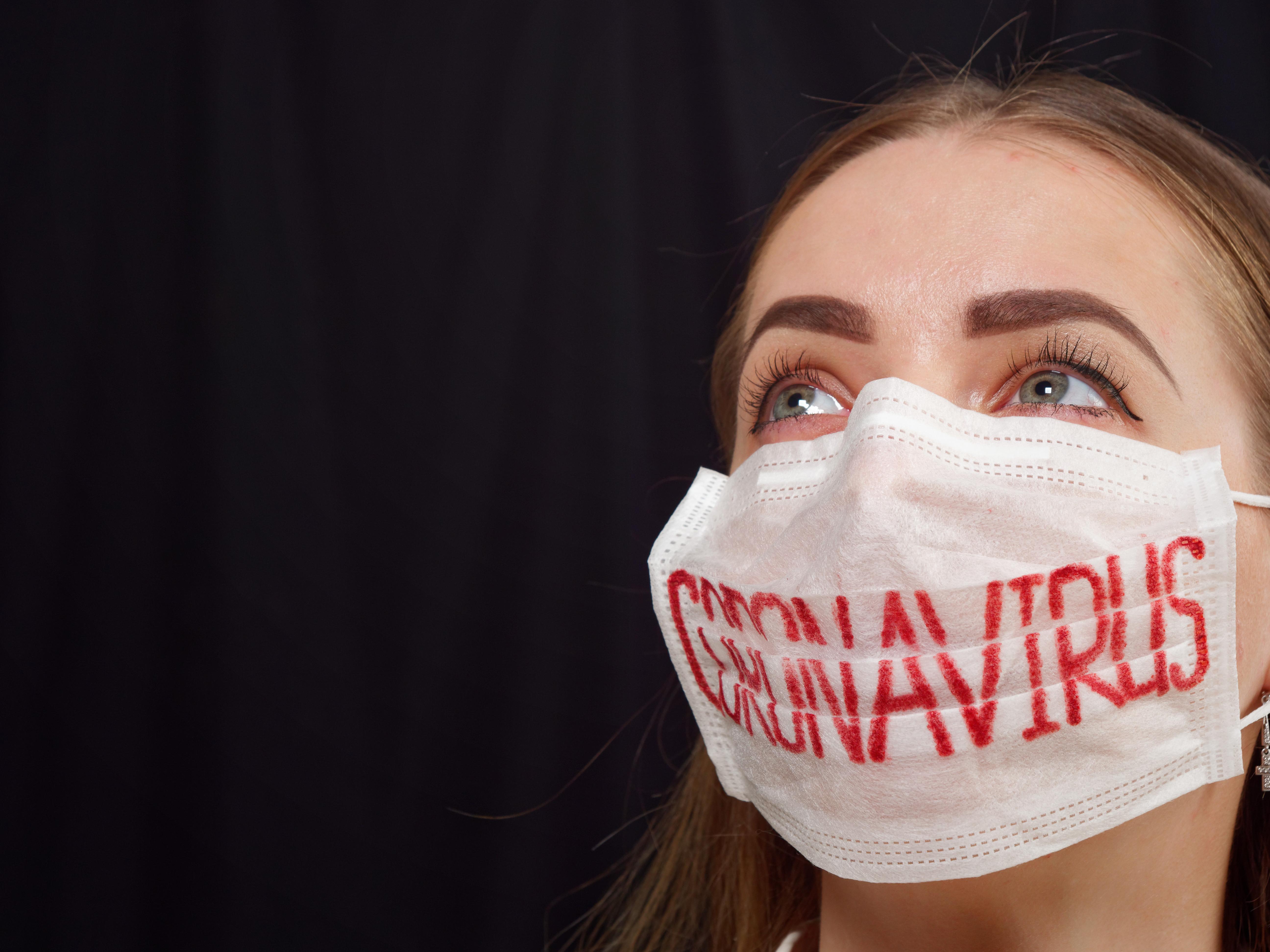 antiviral face mask on a gray background. coronavirus epidemic.